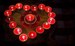 Heart burns with love for Valentine's Day. A heart of fire of love burning red candles Stock Images
