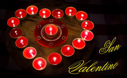 Heart burns with love for Valentine's Day. A heart of fire of love burning red candles Stock Photography