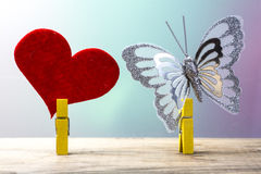 Heart and butterfly attached to clothespin Stock Images