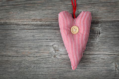 Heart with button Royalty Free Stock Images