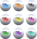 Heart buttons. Collection of colourful gel heart icons set on silver metallic buttons isolated on white Stock Photo