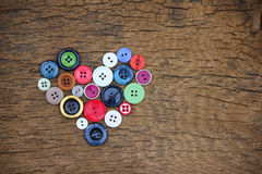 Heart of buttons. Heart of old buttons on wood Royalty Free Stock Photo