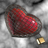 Heart in a cage. Heart in a cage with a padlock Stock Photo