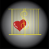 Heart in a cage. Red heart locked in a Golden cage greed, money and power Royalty Free Stock Images