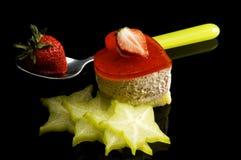 Heart cake. Heart shaped strawberry cake with carambola or star fruit decoration over black background Stock Photo