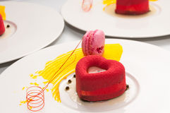 Heart cake with macarons. Delicios cake in the form of heart with pink macarons royalty free stock photos