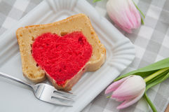 Heart cake with pink tulips Royalty Free Stock Photos