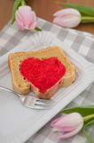 Heart cake with pink tulips Royalty Free Stock Images