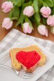 Heart cake with pink tulips Royalty Free Stock Image