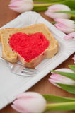 Heart cake with pink tulips Stock Photography