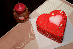 Heart cake and red candles Stock Photos