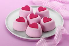 Heart Cakes. Six heart shaped cakes on a plate on a pink background stock photos
