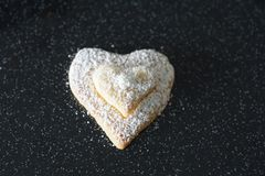 Heart cakes for Christmas. Sweet heart cakes with white pearls for Christmas time in Winter at a bakary in Germany stock photos