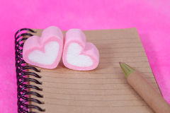Heart candies  with book note ,message paper. Royalty Free Stock Image