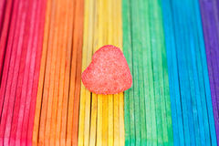 Heart candies coated with sugar sitting on colourful table Stock Image