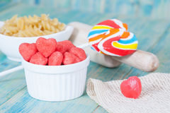 Heart candies coated with sugar in white cup. Stock Photo
