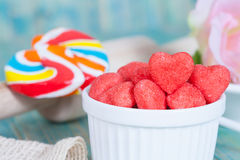 Heart candies coated with sugar in white cup. Royalty Free Stock Photos