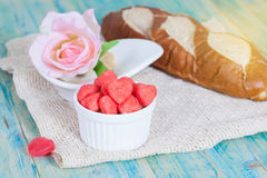 Heart candies coated with sugar in white cup. Stock Photography
