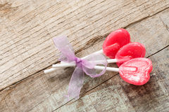 Heart candies over wood Royalty Free Stock Photography