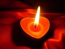 Heart candle. Red heart candle in the dark Stock Photography