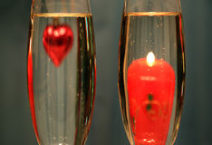 Heart and candle in glasses with champagne Royalty Free Stock Images