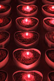 Heart candle holders with lighted candles inside Royalty Free Stock Images