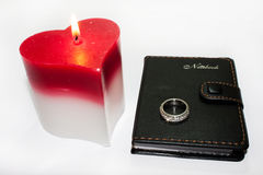 Heart candle and wedding ring Stock Photography