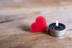Heart and candle on Wooden Background Royalty Free Stock Photography