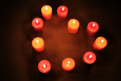 Heart of Candles. Some candles in heart-shaped composition on linen background Royalty Free Stock Photography