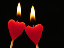 Heart Candles. Two red heart candles close together Royalty Free Stock Photos