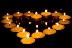 Heart of candles. Isolated on black background Royalty Free Stock Photography