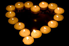 Heart of candles. Isolated on black background Royalty Free Stock Photo