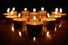 Heart of Candles. A heart made of lit candles in the night reflecting Royalty Free Stock Photos