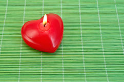 Heart of candles on bamboo Royalty Free Stock Photo
