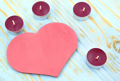 Heart and candles on blue background Royalty Free Stock Image