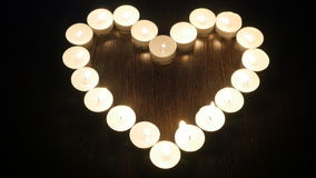 Heart of candles. Candles arranged in a heart shape stock video footage
