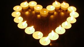 Heart of candles. Candles arranged in a heart shape stock footage