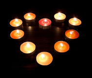 Heart candles on a dark background Royalty Free Stock Photos