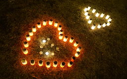 Heart candles. Heart made from candles, shining in the night stock photos