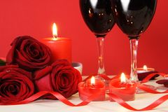 Heart Candles, Red Roses and Wine. Romantic Meal Concept Royalty Free Stock Photo