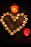Heart of candles. A sign of love. romantic evening Stock Photo