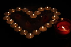 Heart of candles. A sign of love. romantic evening Stock Photos
