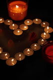 Heart of candles. A sign of love. romantic evening Stock Image