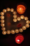 Heart of candles. A sign of love. romantic evening Royalty Free Stock Photography