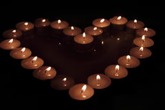 Heart of candles. A sign of love. romantic evening Stock Photography