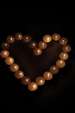 Heart of candles. A sign of love. romantic evening Royalty Free Stock Image