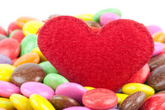 Heart and candy Stock Images