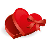 Heart Candy Box. Red box of chocolates in heart shape for Valentine's Day with ribbons Royalty Free Stock Photo