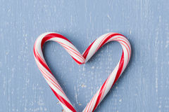 Heart Candy Cane on Light Blue Wood Background Stock Photography