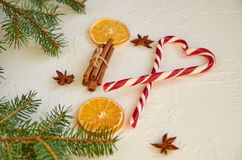 Heart of candy cones and traditional spices for mulled wine: anise stars, cinnamon sticks, dried oranges. New year food decoration royalty free stock images